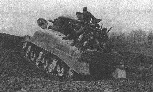 Infantry mounted on medium tank M4A1.