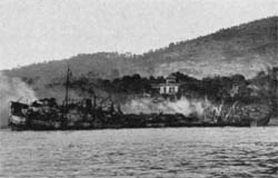 LST, hit by radio-controlled bombs, is hopelessly wrecked.