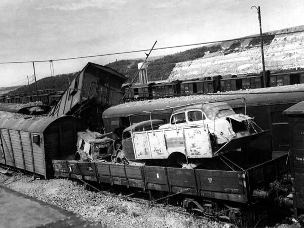 Car in Truck in Railroad Car: Littorio, Italy