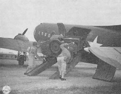 Loading Jeep Up Ramp to C47 Cargo Plane