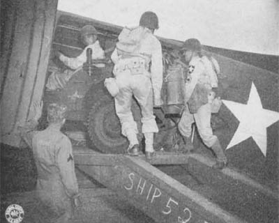 Loading the Jeep 1/4-ton Truck into C-47 Cargo Plane
