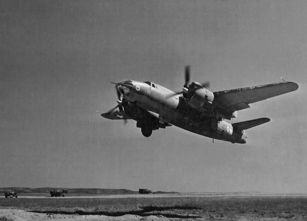 a martin b-26 marauder medium bomber takes off for a mission from an  airfield